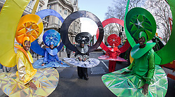 """© Licensed to London News Pictures. 18/03/2012. London, England. The London carnival group """"Mahogan"""" sporting Olympic rings. London celebrates St. Patrick's Day with a parade and festival. Photo credit: Bettina Strenske/LNP"""
