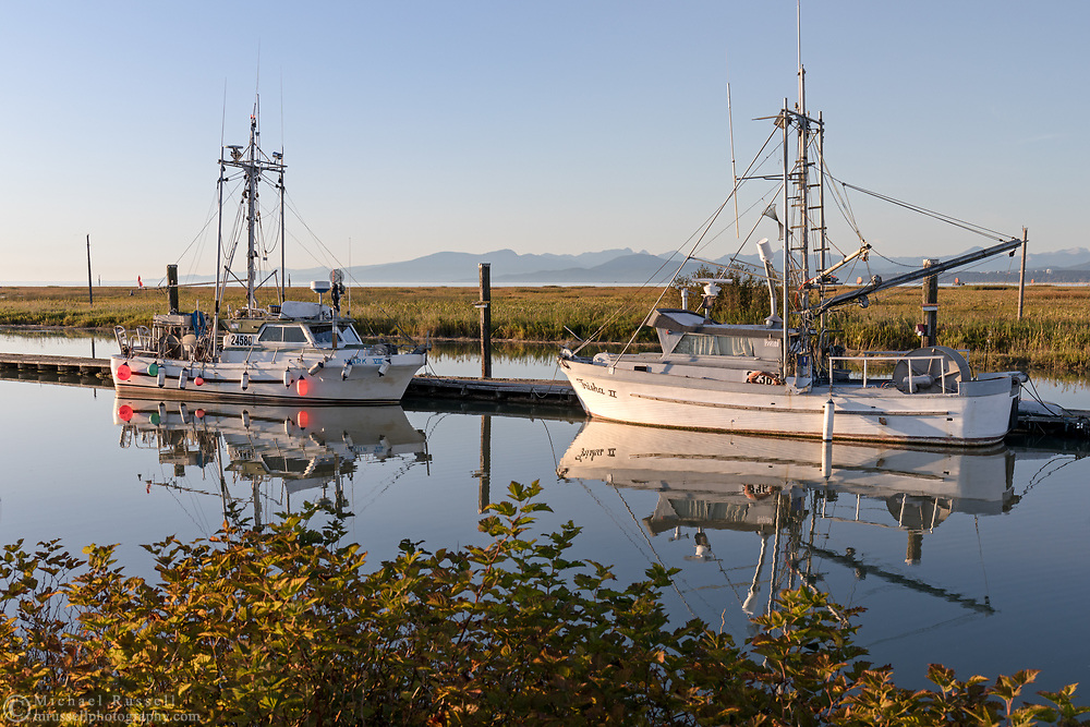 Fishing boats tied up at the docks at Scotch Pond near Steveston in Richmond, British Columbia, Canada.  Photographed from the trails in Garry Point Park.