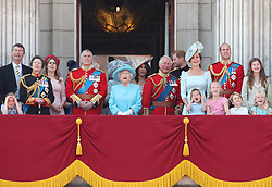 File photo dated 09/06/18 of (left to right) Vice Admiral Sir Timothy Laurence, the Princess Royal, Princess Beatrice, Lady Louis Windsor, Duke of York, Queen Elizabeth II, Duchess of Sussex, Prince of Wales, Duke of Sussex and the Duke and Duchess of Cambridge with Princess Charlotte, Savannah Phillips and Prince George, on the balcony of Buckingham Palace, in central London, following the Trooping the Colour ceremony at Horse Guards Parade. The military parade has marked the official birthday of the sovereign for more than 270 years.