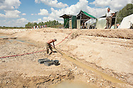 Clearing a drainage channel. Palaeontological excavations at Angeac, Charente, France (July 2016) © Rudolf Abraham