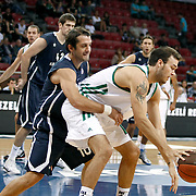 Anadolu Efes's Kerem TUNCERI (L) during their Two Nations Cup basketball match Anadolu Efes between Panathinaikos at Abdi Ipekci Arena in Istanbul Turkey on Saturday 01 October 2011. Photo by TURKPIX