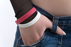 Portrait of a teenage girl wearing awareness wristbands,