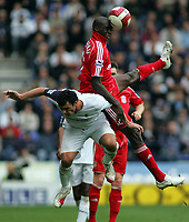Photo: Paul Thomas.<br /> Bolton Wanderers v Liverpool. The Barclays Premiership. 30/09/2006.<br /> <br /> Momo Sissoko of Liverpool out jumps Gary Speed (Bottom).
