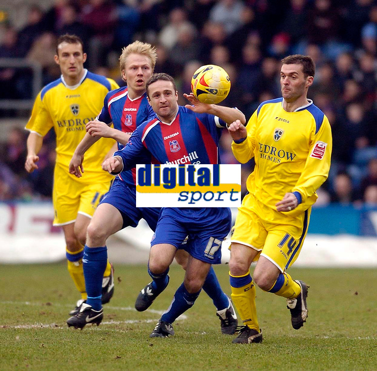 Photo: Alan Crowhurst.<br />Crystal Palace v Cardiff City. Coca Cola Championship. 04/02/2006. <br />Cardiff's Willie Boland (R) challenges Michael Hughes for the ball.