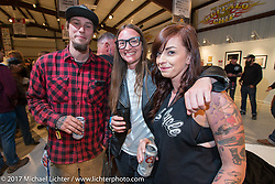 Show particpants Jake Cutler, Christina Platis and Savannah Rose at the Old Iron - Young Blood exhibition media and industry reception in the Motorcycles as Art gallery at the Buffalo Chip during the annual Sturgis Black Hills Motorcycle Rally. Sturgis, SD. USA. Sunday August 6, 2017. Photography ©2017 Michael Lichter.