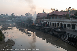 Open air cremations at Pashupatinath Temple, a sacred Hindu temple complex on the banks of the Bagmati River near Kathmandu during our Himalayan Heroes adventure, Nepal. Saturday, November 3, 2018. Photography ©2018 Michael Lichter.