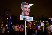 A Remain protester holds a William Rees-Mogg unicorn parody in Westminster before the result of MPs Meaningfull Brexit vote which eventually brought about a massive defeat for Prime Minister Theresa Mays Conservative government, on 15th January 2019, in Westminster, London, England.