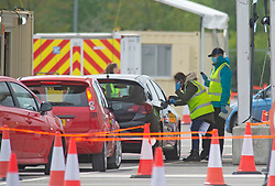 ©Licensed to London News Pictures 30/04/2020  <br /> Ebbsfleet, UK. Queues of people in cars wait while staff in PPE direct them. A Coronavirus testing site for key workers has opened in Ebbsfleet, Kent. The site is mostly a self testing site by appointment only.<br /> Photo credit:Grant Falvey/LNP