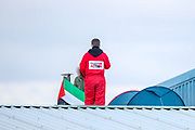 """Tamworth, United Kingdom, May 25, 2021: A """"Palestine Action"""" activists stands on the rooftop after they occupied an Israeli owned weapons manufacturer building in Tamworth, Amington Industrial Estate near Birmingham on Tuesday, May 25, 2021. """"Shut Elbit Down"""", """"Free! Free! Palestine"""" are among the slogans activists shouted whilst on the rooftop of the building. (Photo by Vudi Xhymshiti)"""