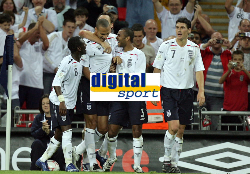 Photo: Rich Eaton.<br /> <br /> England v Russia. UEFA European Championships Qualifying. 12/09/2007. England's Rio Ferdinand (2nd L) celebrates scoring the 3rd goal of the night.