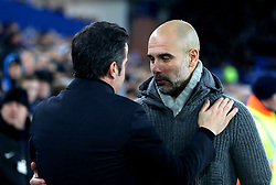 Everton manager Marco Silva (left) and Manchester City manager Pep Guardiola hug each other prior to the beginning of the match