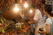 Shop selling cooked meats including crispy duck and pork in Wan Chai's thronging food market on Bowrington Road in Hong Kong, China. Almost any food can be bought here, both fresh or cooked. Wan Chai is a busy Chinese shopping district totally different to nearby westernised Central.