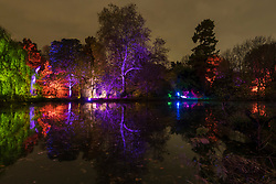 © Licensed to London News Pictures. 15/11/2019. LONDON, UK.  Illuminations around the lake as The Enchanted Woodland opens on a rainy evening at Syon House in West London.  An illuminated trail takes visitors through gardens designed by Capability Brown, round an ornamental lake and ends at the spectacular Great Conservatory.  The show is open to the public 15 November to 1 December.  Photo credit: Stephen Chung/LNP