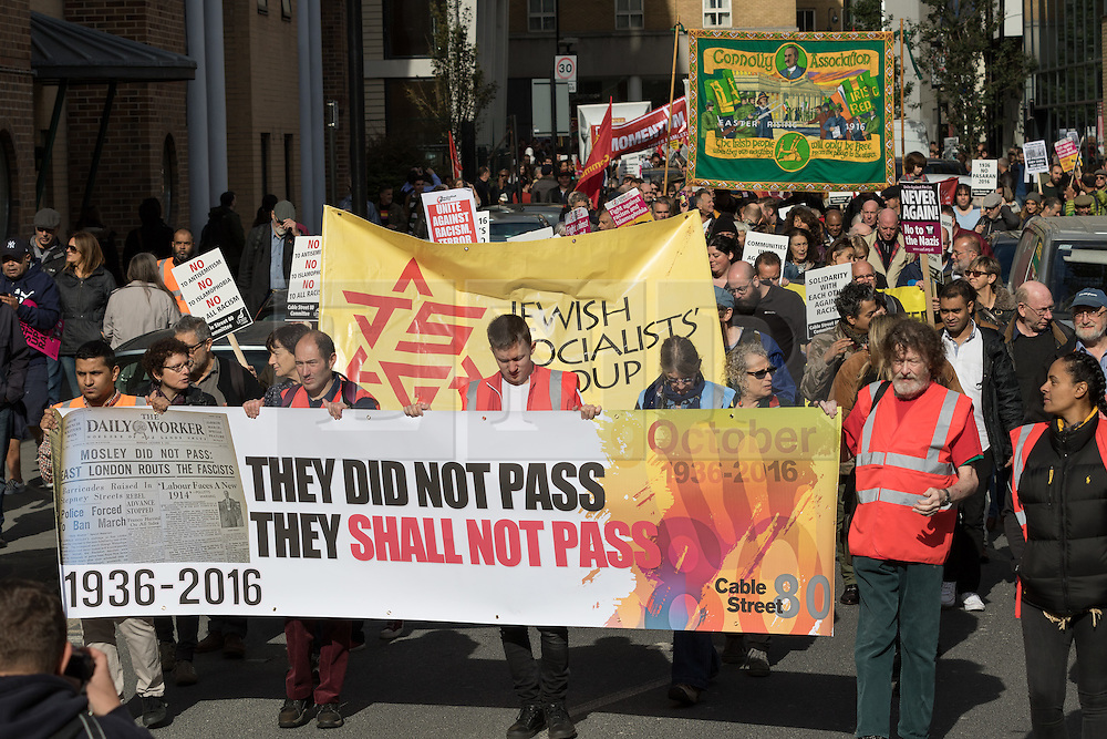 © Licensed to London News Pictures. 09/10/2016. LONDON, UK.  Socialists, Trade Unionists, Jewish and anti racism groups take part in a march and rally from Altib Ali Park in Whitechapel to Cable Street to mark the 80th anniversary of the Battle of Cable Street and commemorate the defeat of fascism and Sir Oswald Mosley's British Union of Fascists (whose members were known as Blackshirts) in London's east end in 1936. The activists today are also protesting against the rising number of racist and anti-semitic hate crimes in London following Brexit. On 4th October, 1936 the police tried to escort Mosley and his Blackshirts along Cable Street, but they were stopped by local Jewish, Irish and English residents who built barricades and hurled back the fascists by force.  Photo credit: Vickie Flores/LNP