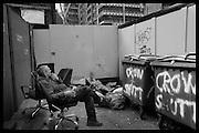 Polish man called Jarek relaxing in the morning behind huge building development. inc luxury flats  Bishopsgate near Liverpool St. London. 26 February 2016