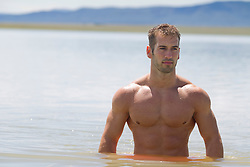 sexy man waist deep in a lake in New Mexico