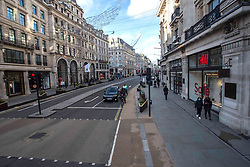 © Licensed to London News Pictures.20/12/2020, London, UK. Only a handful of Londoners in Regent Street. London enters Tier 4 severe restrictions as new Mutant Covid-19 strain is found. The new variant of the virus has been found to be 70% more infectious and is currently rampant throughout London and the South East of England. Photo credit: Marcin Nowak/LNP