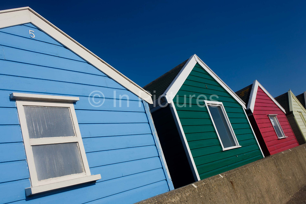 Expensive real estate beach hut at the Suffolk seaside town of Southwold, Suffolk,known for its lack of branded commercialism. A beach hut (also known as a beach cabin or bathing box) is a small, usually wooden and often brightly coloured, box. The huts are an iconic image resorts such as Southwold, the most quintessential of British beach holiday destinations. Today Southwold's beach huts are most likely to hit the national media because of their value meaning that they sell for large sums of money. Estate agents Durrants say huts on the promenade behind the sale item can go for £100,000. In 2012 a derelict beach hut in Southwold was on the market for £40,000.