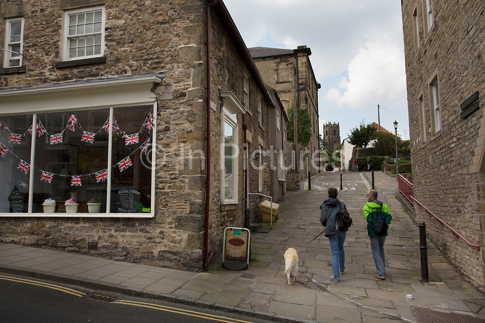 Union Jack flags in a shop window in Richmond, a market town and the centre of the district of Richmondshire. Historically in the North Riding of Yorkshire, it is situated on the edge of the Yorkshire Dales National Park. North Yorkshire, England, UK.