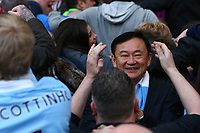 Football - Premier League - Manchester City vs. Manchester United<br /> Ex Manchester City owner Thaksin Shinawatra in the crowd amongst fans doing the Poznan at the Etihad Stadium