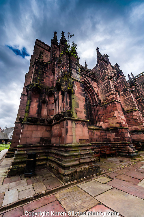 color images Chester city cathedral, showing elevation and architectural details including spires and buttresses, stained glass windows and surrounding gardens and flower beds