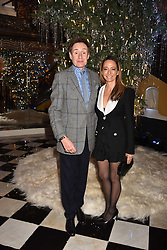 Nick Foulkes and Whitney Bromberg-Hawkings at reception to celebrate the launch of the Claridge's Christmas Tree 2017 at Claridge's Hotel, Brook Street, London England. 28 November 2017.