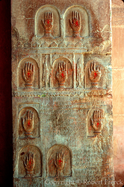 INDIA, RAJASTHAN carved hands symbolize women who have  committed Sati, choosing to be cremated with their dead husbands