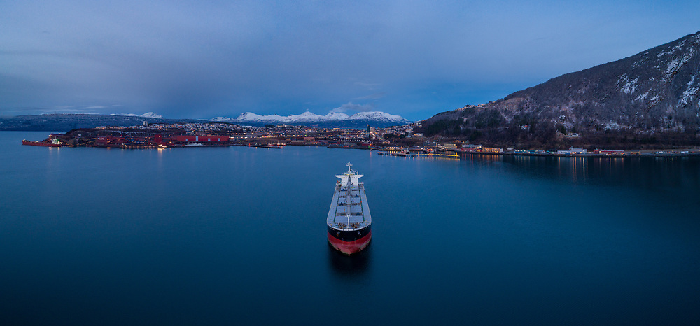 Arial panorama view of the bulk carrier 'IVS Phoenix' anchored in the port of Narvik in Northern Norway.
