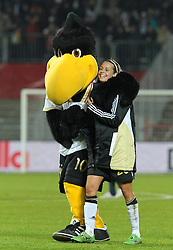 26.10.2011, Millerntor-Stadion, Hamburg, GER, FSP, Deutschland vs Schweden, im Bild DFB-Maskottchen Paule mit Lena Goeßling (Deutschland #20)..// during the friendly match Deutschland vs Schweden on 2011/10/26, Millerntor-Stadion, Hamburg, Germany..EXPA Pictures © 2011, PhotoCredit: EXPA/ nph/  Frisch       ****** out of GER / CRO  / BEL ******