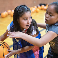 Rae Chicharello, 9, left, looks to pass during a scrimmage Monday, June 3 at the Bengal Basketball Kids Camp at Gallup High School.