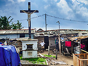 07 OCTOBER 2017 - MORATUWA, SRI LANKA: A Catholic crucifix towers over  Moratuwa, a fishing village south of Colombo. About 8% of Sri Lanka is Christian, the majority of which are Roman Catholic. Catholicism was spread by Portuguese colonizers who came to Sri Lanka in the 1500 and 1600s. The village is majority Catholic. Fish is an important source for many Sri Lankans.  PHOTO BY JACK KURTZ