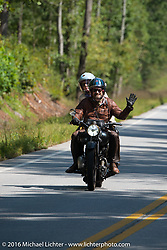 Paul D'Orleans riding Bryan Bossier's 1933 Brough Superior 11-50 with partner and passenger Susan McLaughlin during Stage 3 of the Motorcycle Cannonball Cross-Country Endurance Run, which on this day ran from Columbus, GA to Chatanooga, TN., USA. Sunday, September 7, 2014.  Photography ©2014 Michael Lichter.