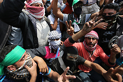 April 27, 2018 - Khan Younis, Gaza Strip, Palestinian Territory - Palestinian protesters shout slogans during clashes with Israeli security forces in tents protest demanding the right to return to their homeland, at the Israel-Gaza border, in Khan Younis in the southern Gaza Strip.  (Credit Image: © Ashraf Amra/APA Images via ZUMA Wire)
