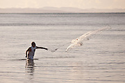 A fisherman casts his net on Corcega Beach in Rincon, Puerto Rico. Rincon is one of the surf capitals of the world.