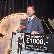 NLD/Amsterdam/20171114 - Esquire's Best Dressed Man 2017, prijswinnaar Klaas Dijkhoff krijgt zijn prijs overhandigd