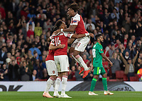 Football - 2018 / 2019 UEFA Europa League - Group E: Arsenal vs. Vorskla Poltava<br /> <br /> Alex Iwobi (Arsenal FC) leaps onto goalscorer Pierre-Emerick Aubameyang (Arsenal FC) after he scores his second goal at The Emirates.<br /> <br /> COLORSPORT/DANIEL BEARHAM