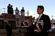 """TOKYO-- OCT 30 2003- Before a rally for Naoto Kan head of the Democratic Party of Japan (DPJ)  largest Opposition Party to the Koizumi's Liberal Democratic Party( LDP) goverment,  Passes out Kan's """"Manifesto"""" for  change."""