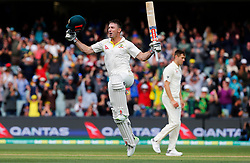 Australia's Shaun Marsh celebrates his century during day two of the Ashes Test match at the Adelaide Oval, Adelaide.