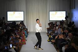 August 18, 2017 - Toronto, Ontario, Canada - Designer Smail Akdim acknowledging the audience during the African Fashion Week in Toronto, Canada on 18 August 2017. (Credit Image: © Arindam Shivaani/NurPhoto via ZUMA Press)