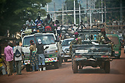 """Soldiers, formerly Séléka rebels holding AK-47's, patrol in a pick-up truck near the power plant in Bangui as Central Africans ride on a lorry, serving as public transportation. Séléka, meaning """"union"""" or """"allegiance"""" in Sango language, propelled the current CAR interim President Michel Djotodia into power Séléka forces are still causing instability in the country, waging battles with pro-Bozizé supporters known as Anti-Balaka to this date. The insecurity drove the country into total chaos in almost every sector, as its citizens merely try to survive from day to day. In November 2013 United Nations Secretary-General Ban Ki-moon noted that the security situation in the country remained precarious with government authority nonexistent outside of Bangui."""