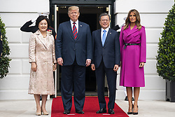 US President Donald J. Trump (C-L) and First Lady Melania Trump (R) welcome Korean President Moon Jae-in (C-R) and Mrs. Kim Jung-sook (L) to the South Portico of the White House in Washington, DC, USA, 11 April 2019. President Moon is expected to ask President Trump to reduce sanctions on North Korea in an attempt to jump start nuclear negotiations between North Korea and the US.