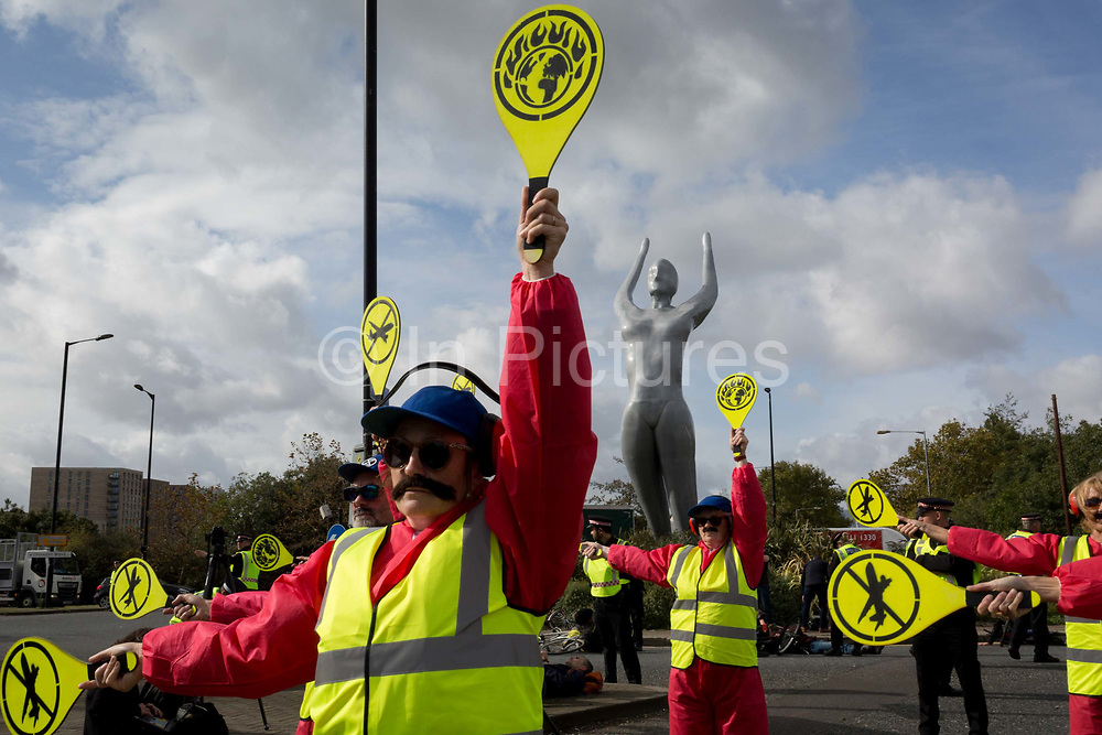 Environmental activist protest about Climate Change during the occupation of City Airport Londons Business Travel hub in east London, the fourth day of a two-week prolonged worldwide protest by members of Extinction Rebellion, on 10th October 2019, in London, England.