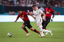 July 31, 2018 - Miami Gardens, Florida, USA - Manchester United F.C. forward Alexis Sanchez (7) (left) competes for the ball with Real Madrid C.F. midfielder Federico Valverde (37) (center) as Manchester United F.C. defender Eric Bailly (3) (right) follows during an International Champions Cup match between Real Madrid C.F. and Manchester United F.C. at the Hard Rock Stadium in Miami Gardens, Florida. Manchester United F.C. won the game 2-1. (Credit Image: © Mario Houben via ZUMA Wire)