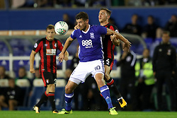 Birmingham City's Lukas Jutkiewicz (left) AFC Bournemouth's Dan Gosling battle for the ball during the Carabao Cup, Second Round match at St Andrew's, Birmingham.