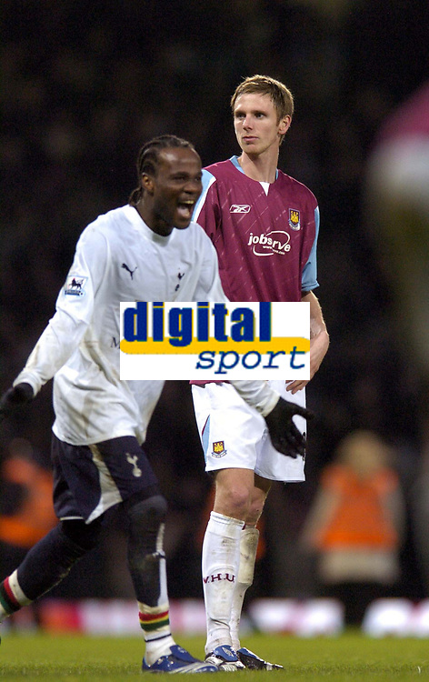 Photo: Olly Greenwood.<br />West Ham United v Tottenham Hotspur. The Barclays Premiership. 04/03/2007. West Ham's Calum Davenport looks dejected while Spurs Pascal Chimbonda celebrates at the end of the game