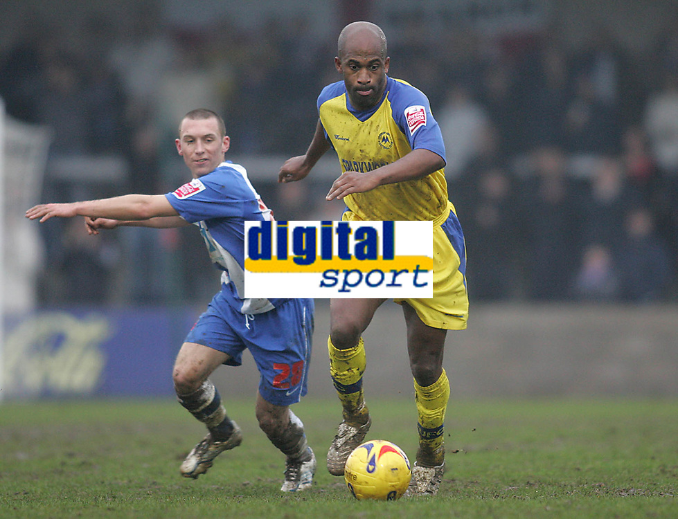 Photo: Lee Earle.<br /> Torquay United v Hartlepool United. Coca Cola League 2. 17/02/2007.Torquay's new signing Dean Gordon (R) sprints away from David Foley.