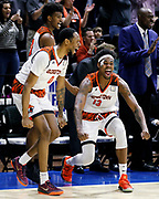 Georgetown's (Ky.) Troy Steward (20) Brodricks Jones (0) and Chris Coffey (13) celebrate in the final seconds of the NAIA championship men's college basketball game, Tuesday, March 26, 2019, in Kansas City, Mo. Georgetown defeated Carroll 68-48. (AP Photo/Colin E. Braley)