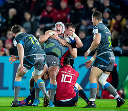 Hanno Dirksen of Ospreys is tackled by Jean Kleyn of Munster <br /> <br /> Photographer Simon King/Replay Images<br /> <br /> European Rugby Champions Cup Round 1 - Ospreys v Munster - Saturday 16th November 2019 - Liberty Stadium - Swansea<br /> <br /> World Copyright © Replay Images . All rights reserved. info@replayimages.co.uk - http://replayimages.co.uk