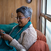 Mala Srikanth, founder of the women's knitting circle in Ranikhet, India, works on a personal sweater in her home in Ranikhet, India on Dec. 6, 2018.