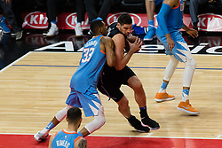 March 10, 2018 - Los Angeles, CA, U.S. - LOS ANGELES, CA - MARCH 10: Orlando Magic center Nikola Vucevic (9) drives to the basket against LA Clippers forward Wesley Johnson (33) during the game between the Orlando Magic and the LA Clippers on March 10, 2018, at STAPLES Center in Los Angeles, CA. (Photo by David Dennis/Icon Sportswire) (Credit Image: © David Dennis/Icon SMI via ZUMA Press)